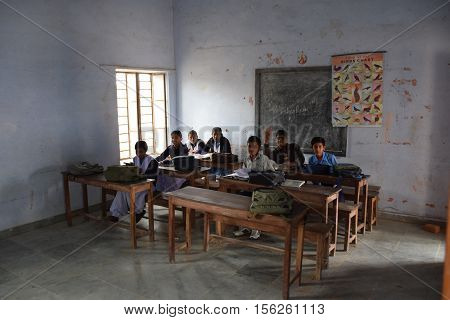 RAJASTHAN, INDIA - FEBRUARY 15, 2016 - Unidentified indian kids in their classroom in a poor village school