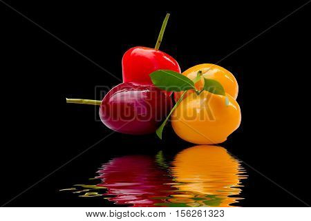 Fruit snacks isolated on black background. thai dessert called Look-shoop artificial fruit and colorful