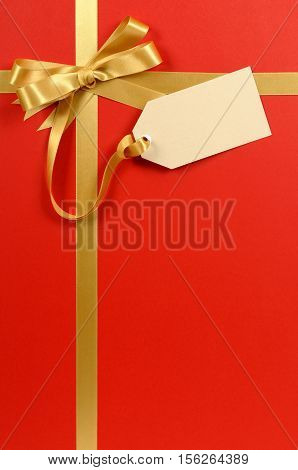 Red Gift Background, Gold Ribbon Bow, Blank Gift Tag Or Label, Copy Space, Vertical