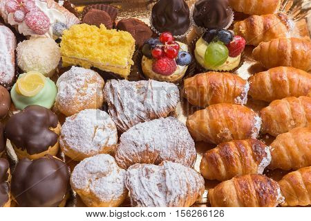 Typical italian pastries stuffed close up from above.