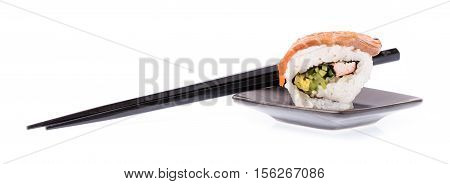 Dish Of Sushi With Chopsticks Isolated On White Background