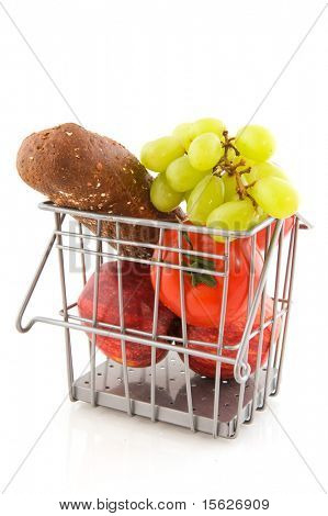Basket with vegetables fruit and bread on white background
