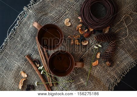 Autumn Composition: 2 Cups, Cinnamon, Pinecones On The Canvas Cloth