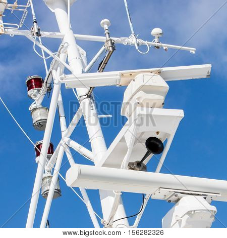 Mast of a modern ship with a horn lamps and other equipment - Selective focus