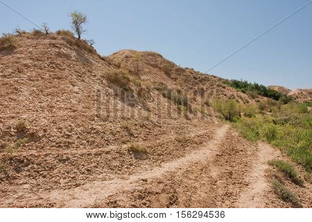 Blue sky over dry land hill of mountain plateau in Central Asia