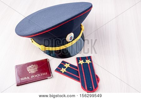 Still Life: cap epaulets of lieutenant colonel and a certificate of the Russian Interior Ministry