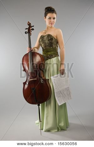 Beautiful Woman With Cello And Score