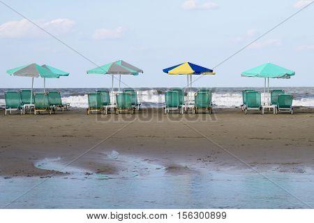 umbrellas and sun beds on the beach Greece