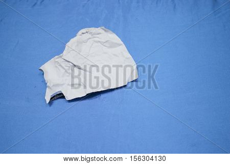 Crumpled paper and texture on blue table background in business meeting room with copy space