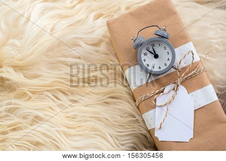 grey clock on christmas gift box with blank gift white tag