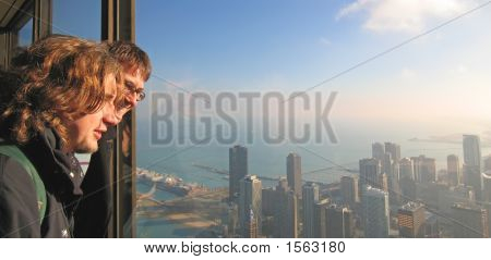 Two Young Boy Tourist Looking On The Chicago Bay From John Hancock Building, Chicago, United States
