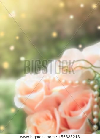 sweet dreamy and de-focused close up bouquet of pink roses on green background vintage with flare light