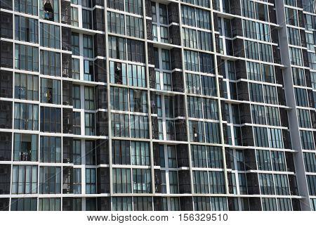 Building image : Condo windows and balconies viewed