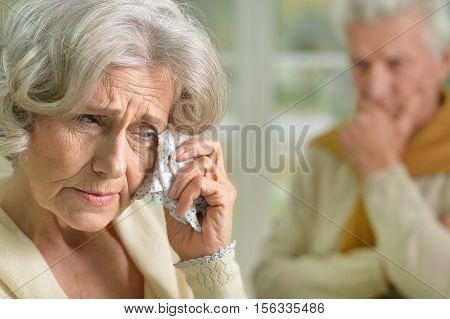 Portrait of upset senior woman holding handkerchief