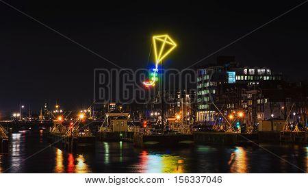 Amsterdam Netherlands - December 18 2015: Light Festival Amsterdam neon light kite above the port of Amsterdam