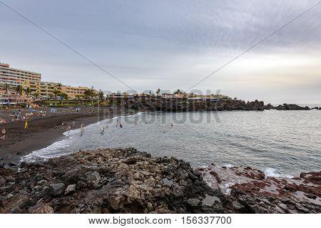 LOS GIGANTES, TENERIFE, SPAIN - DECEMBER 2015: People have a joy at black sand beach at Los Gigantes town on Tenerife island, Spain