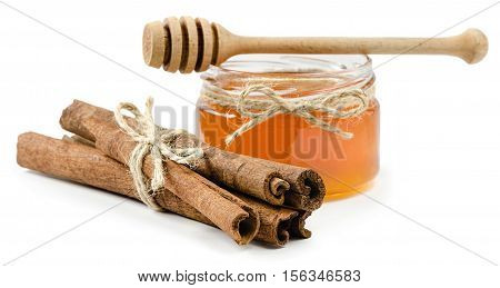 honey pot cinnamon on an isolated white background, rope