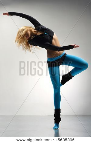 young stylish girl dancing modern ballet dance