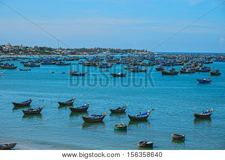 Vietnamese fishing village Mui Ne Vietnam Southeast Asia. Landscape with sea and traditional colorful fishing boats at Muine. Scenic sea bay. Popular landmark and tourist destination of Vietnam.