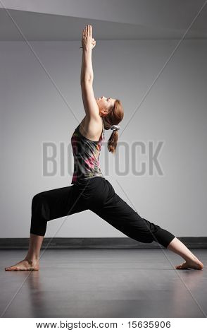 young beautiful woman doing yoga exercise