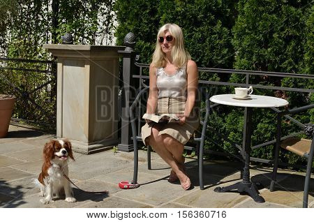 Woman Relaxing With Doggy