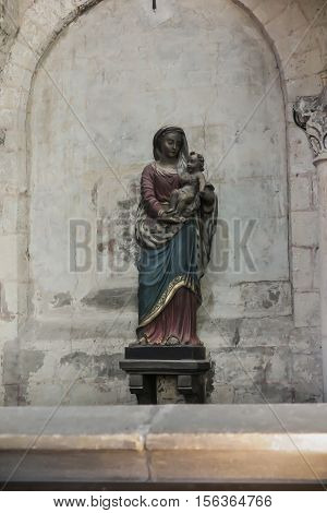 Poitiers France - September 12 2016 Old famous roadside statue of the Virgin Mary with the Child at Which often prayed St. Louis Montfort now moved to the church of st. Radegund in Poitiers France