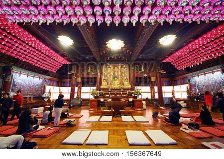 SEOUL - NOV 04, 2015: Believers pray in Bongeunsa temple, Bongeunsa is Buddhist temple located in Samseong-dong, Gangnam-gu, It was founded in 794
