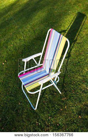 garden chair on green grass background