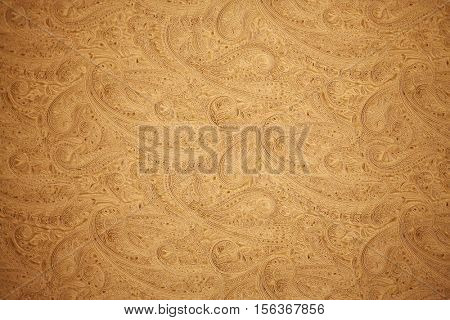 SHANGHAI, CHINA - NOV 7, 2015: Embossed floral arabic pattern on yellow paper in Dardeco shop
