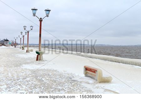 City embankment covered with ice after a winter storm