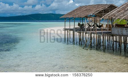 Water Hut of Homestay on Sandy Bank - Kri Island. Raja Ampat, Indonesia, West Papua.