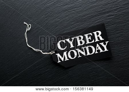 Cyber Monday Sale tag on dark slate background