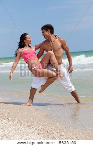 posing beautiful couple on the sea beach