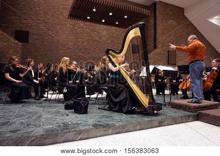 ROMEOVILLE, ILLINOIS / UNITED STATES - OCTOBER 26, 2016: Dr. Lawrence Sisk conducts the Metropolitan Youth Symphony Orchestra during a rehearsal prior to a concert at Lewis University.