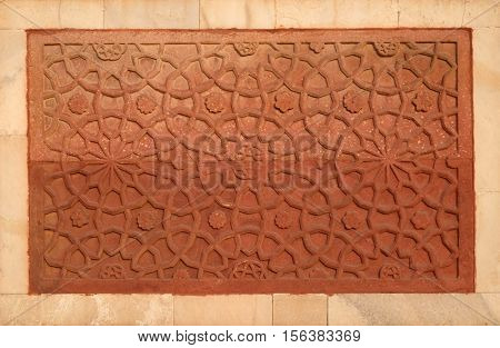 AGRA, INDIA - FEBRUARY 14: Stone pattern on a temple wall in Red Fort, Agra, UNESCO World heritage site, India on February 14, 2016.