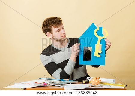 Man With Paper House And Key.