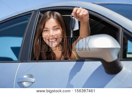 poster of Driving new rental car or drivers license concept. Young teenager woman driver holding car key drivi