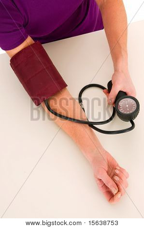 woman with sphygmomanometer machine in white background