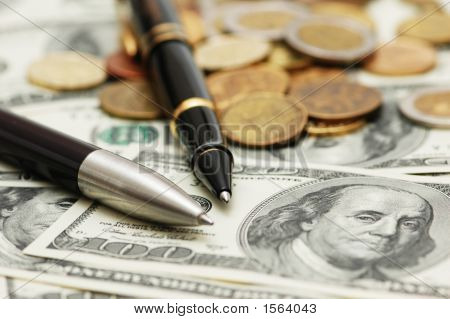 Two Ballpens Over The Hundred Dollar Banknotes
