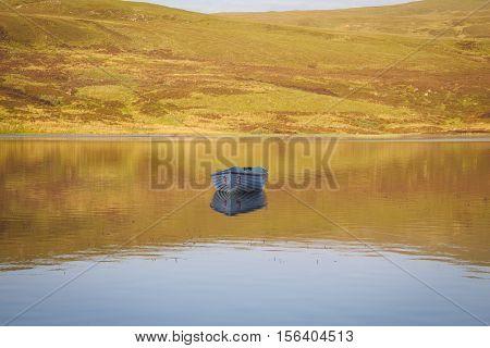 Rowing boats on Loch Fada Isle of Skye Scotland