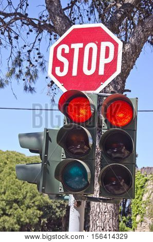 Traffic-light in street and road sign STOP