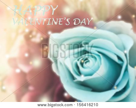 sweet dreamy and de-focused word Happy valentine's day on vintage background bouquet of blue roses with flare light