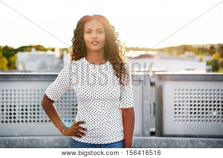Calm Beautiful Woman With Hand On Hip Outdoors