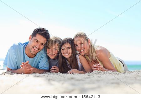 Children with their parents at the beach
