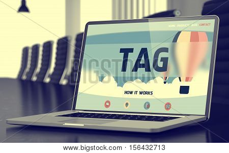 Tag Concept. Closeup Landing Page on Mobile Computer Screen on Background of Conference Hall in Modern Office. Toned. Blurred Image. 3D Rendering.