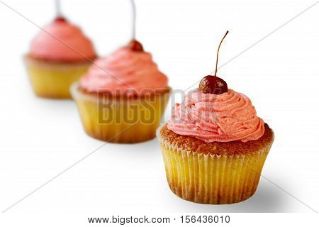 Cupcakes with pink frosting. Baked desserts on white background. Joy has a flavor. Discover the wonders of cooking.