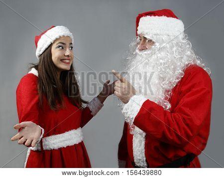 Santa Claus rebuke the naughty girl elf