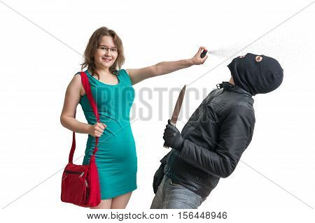 Self Defense Concept. Young Woman Is Defending Herself With Pepp