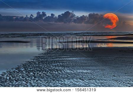Super moon at sandy beach of the Baltic Sea,