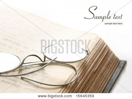 old eyeglass on a old book and easy to remove the text